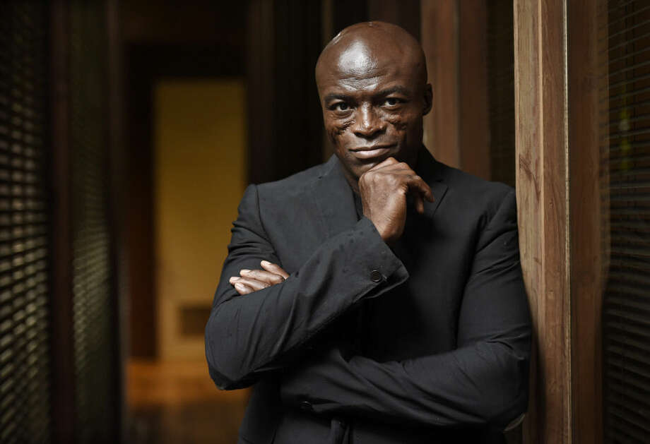 "In this Monday, Oct. 5, 2015 photo, singer/songwriter Seal poses for a portrait at Warner Bros. Records in Burbank, Calif. ""Seal 7"" is the artist's first new music in five years: an album about love, heartbreak and healing. (Photo by Chris Pizzello/Invision/AP)"