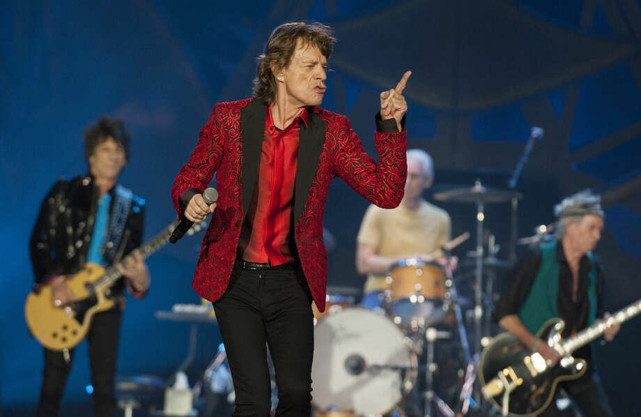 "FILE - In this July 4, 2015 file photo, Ronnie Wood, Mick Jagger, Charlie Watts and Keith Richards of the Rolling Stones perform at the Indianapolis Motor Speedway in Indianapolis. On Thursday, Nov. 5, 2015, the band announced ""The America Latina Olé"" tour, which will kick off Feb. 3 in Santiago, Chile. (Photo by Barry Brecheisen/Invision/AP)"