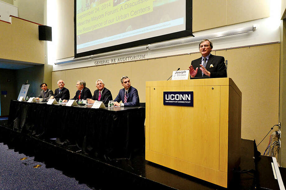 "Hour photo / Erik Trautmann The Business Council of Fairfield County's Joe McGee maderates a panel discussion as part of The Society for Marketing Professional Services and Construction Institute's ""Meet the Mayors Forum"" at UCONN Stamford Wednesday morning."