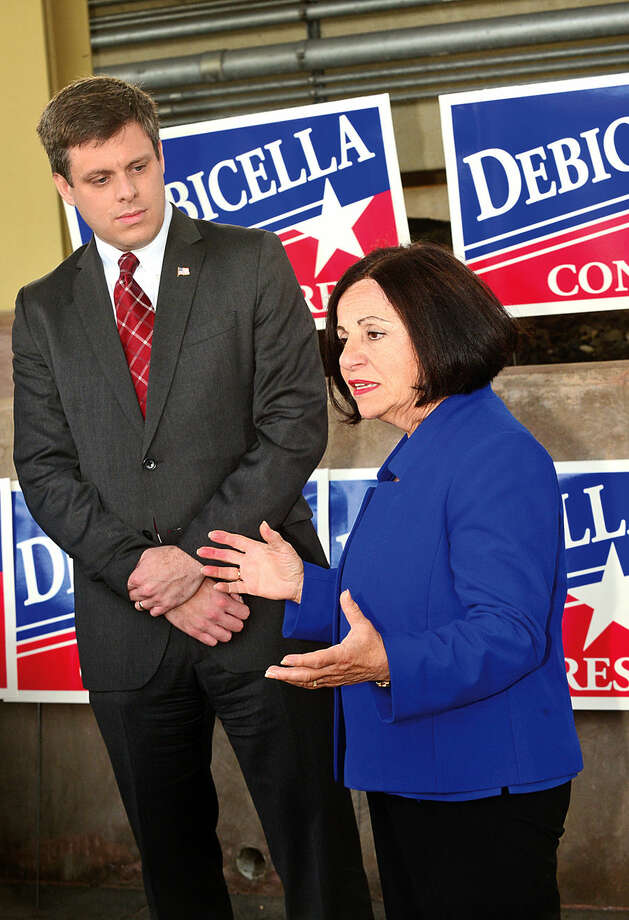 Hour photo / Erik Trautmann Dan Debicella, businessman and GOP candidate for the 4th Congressionl District seat makes a transportation announcement at the Westport train station Wednesday moring with support from State Senator Toni Boucher (R-26).
