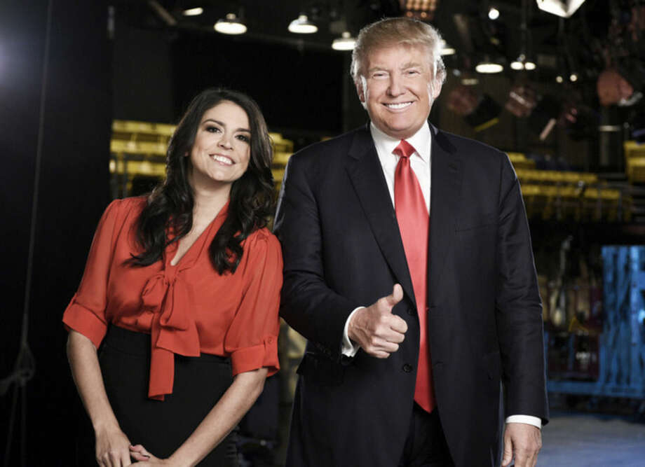 "This Tuesday, Nov. 3, 2015 photo provided by NBC shows, Cecily Strong, left, and Donald Trump from the episode ""Donald Trump"" on ""Saturday Night Live."" Pressure continued to mount on NBC to cancel Trump's guest-host appearance on this weekend's ""Saturday Night Live"" as a coalition of advocacy groups delivered petitions to the network Wednesday, Nov. 4, 2015, calling for him to be dropped from the show. (Dana Edelson/NBC via AP)"