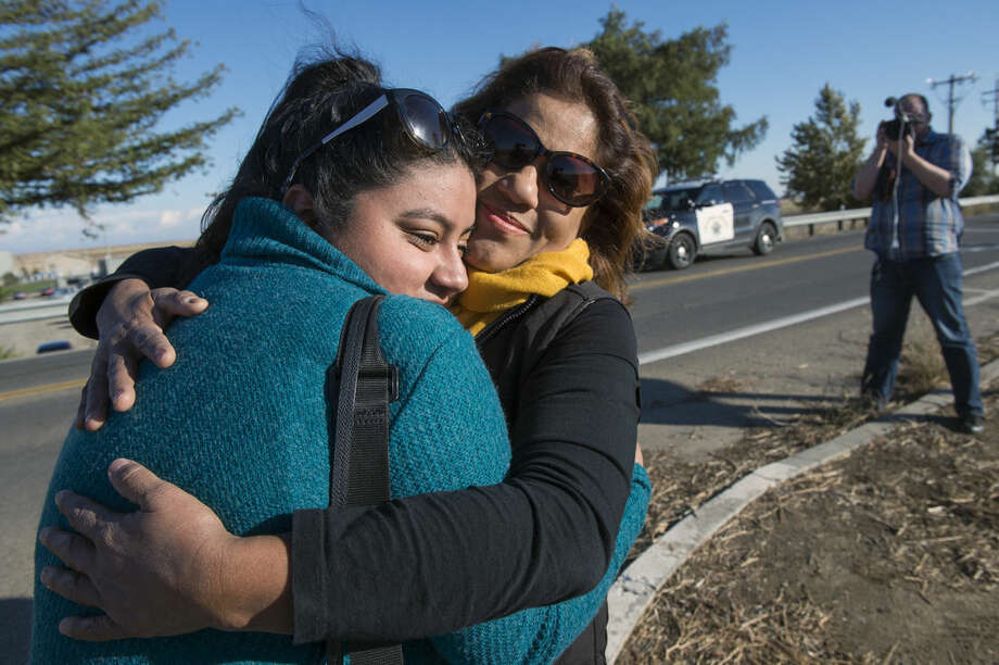 University of California, Merced studenKaren Bustamante, 18, hugs her mom Gloria Bustamante of San Leandro, Calif., after she left the UC Merced campus following a stabbing in Merced, Calif., Wednesday, Nov. 4, 2015. An assailant stabbed five people at the rural university campus in central California before police shot and killed him, authorities said Wednesday. (Paul Kitagaki Jr.(Paul Kitagaki Jr./The Sacramento Bee via AP) MAGS OUT; LOCAL TELEVISION OUT (KCRA3, KXTV10, KOVR13, KUVS19, KMAZ31, KTXL40); MANDATORY CREDIT (REV-SHARE) (ONLN OUT; IONLN OUT - MBI)