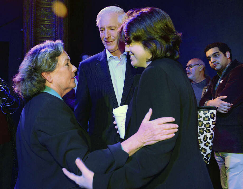 Bridgeport Mayoral candidate Mary-Jane Foster talks to Mayor Bill Finch and his wife Sonya, right, after Foster's concession speech at the Bijou Theater in Bridgeport, Conn., Tuesday Nov. 3, 2015. Joe Ganim entered the election as the endorsed candidate of the hard-luck city's most powerful party after defeating two-term incumbent Mayor Bill Finch in the primary. Ganim, an ex-convict who spent seven years in federal prison for corruption reclaimed the Bridgeport mayor's office Tuesday. (Christian Abraham/Hearst Connecticut Media via AP) MANDATORY CREDIT