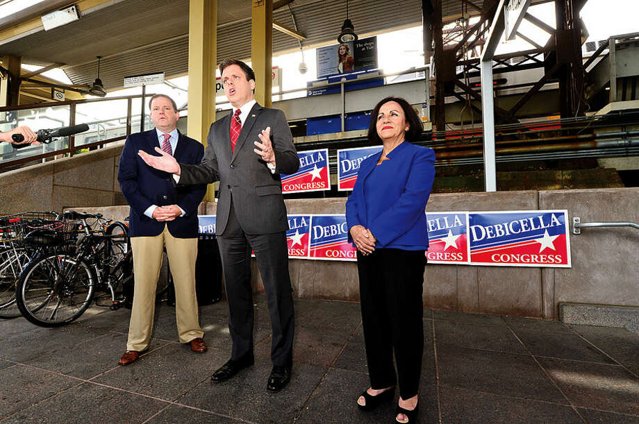Hour photo / Erik Trautmann Dan Debicella, businessman and GOP candidate for the 4th Congressionl District seat makes a transportation announcement at the Westport train station Wednesday with support from Senate Minority Leader John McKinney and State Senator Toni Boucher (R-26).