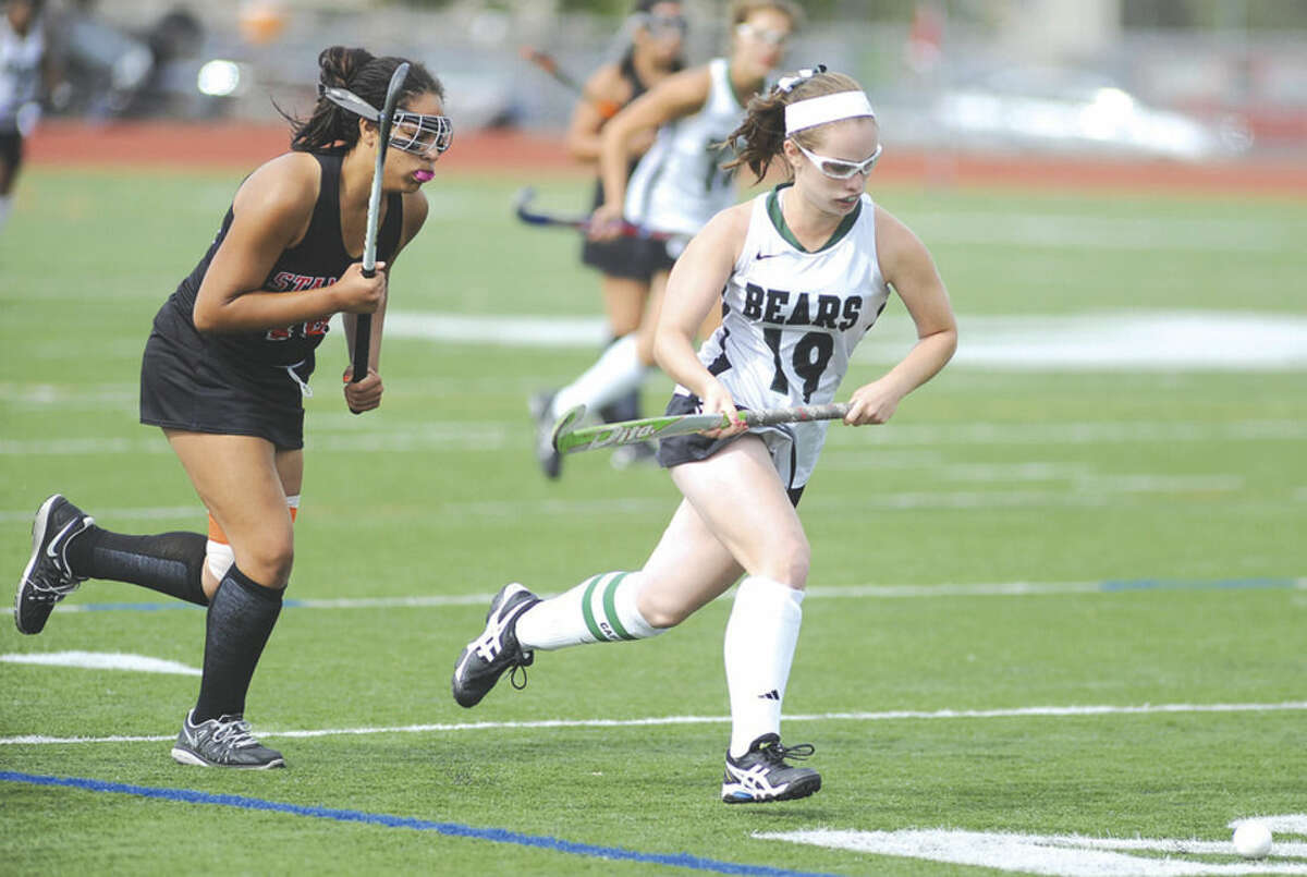 Hour photo/John Nash Norwalk's Allie Hall, right, pushes the ball up the field ahead of Stamford's Alexa Baer during the first half of Wednesday afternoon's game at Testa Field. Hall finished the run with her first of three goals, leading Norwalk to a 5-0 win.