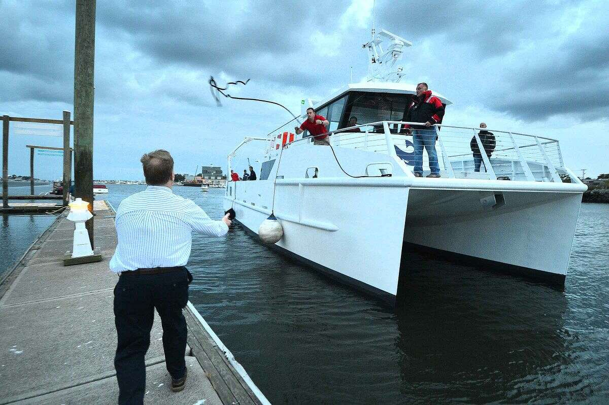 Hour Photo/Alex von Kleydorff The Maritime Aquarium welcomes their new vessel R/V Spirit of The Sound to Norwalk as they tie up with the help of The Aquarium's COO Roy A. Dowdell helping to grab a line at the town docks at Veterans Park on Wednesday night