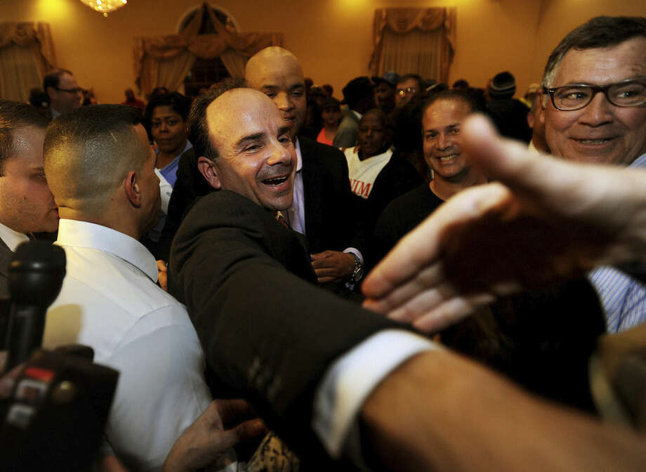 Democrat Joe Ganim celebrates after winning the election as Bridgeport's new mayor at Testo's Restaurant in Bridgeport, Conn., Tuesday, Nov. 3, 2015. Ganim, an ex-convict who spent seven years in federal prison for corruption, reclaimed the Bridgeport mayor's office Tuesday, completing a stunning comeback bid that tapped nostalgia for brighter days in Connecticut's largest city. (Brian A. Pounds/Hearst Connecticut Media via AP) MANDATORY CREDIT