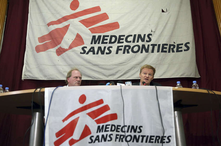 Christopher Stokes, the general director of Doctors Without Borders, right, talks as Michiel Hofman, the head of Kunduz incident team and a Doctors Without Borders employee, listens during a press conference at their office in Kabul, Afghanistan, Thursday, Nov. 5, 2015. The international medical charity, known by its French acronym MSF, said wounded Taliban fighters were being treated in an Afghan hospital bombed by U.S. forces last month but that there were no armed men or fighting in the area. (AP Photos/Massoud Hossaini)