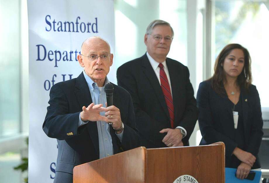"""Dr. Michael Parry, director of infectious diseases at Stamford Hospital, talks about ways to """"Fight the Flu"""" during the campaign kick off at the Stamford Government Center Tuesday."""