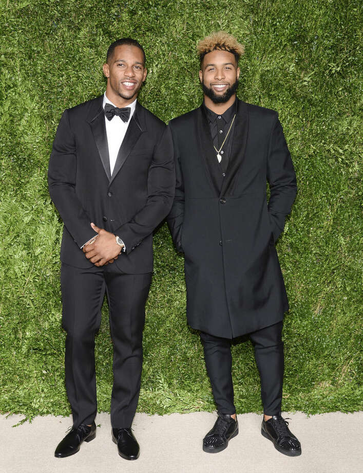 NFL players Victor Cruz, left, and Odell Beckham Jr. attend the 12th Annual CFDA/Vogue Fashion Fund Awards at Spring Studios on Monday, Nov. 2, 2015, in New York. (Photo by Evan Agostini/Invision/AP)