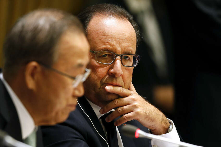 United Nations Secretary-General Ban Ki-moon, left, delivers remarks as President Francois Hollande of France looks on at a news conference on climate change during the Climate Summit at U.N. headquarters, Tuesday, Sept. 23, 2014. (AP Photo/Jason DeCrow)
