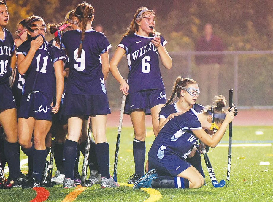 Hour photo/John Nash - Members of the Wilton field hockey team react after Thursday's FCIAC championship game ended in favor of Darien, 1-0, at Casagrande Field in Norwalk.