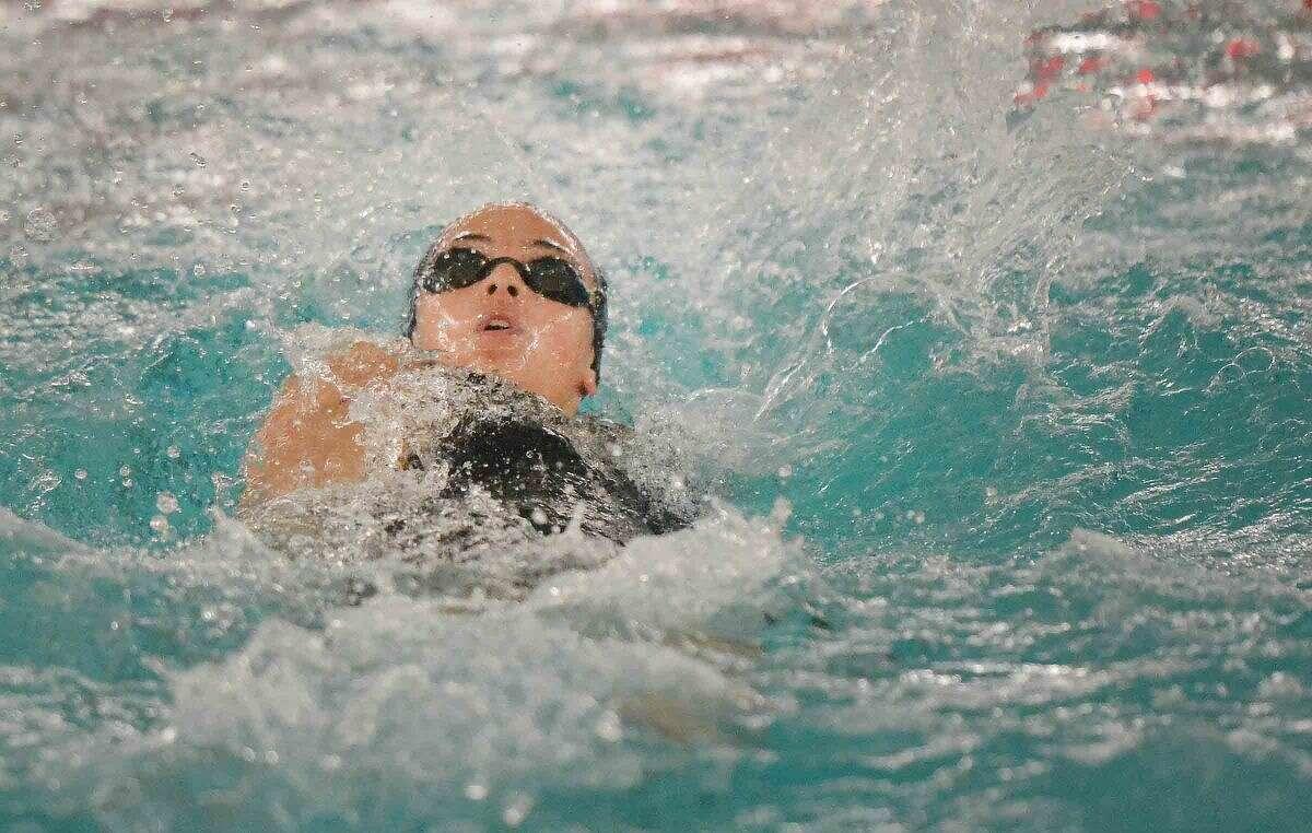 Hour Photo/Alex von Kleydorff Norwalk McMahons Isabel Anbar in the 100 backstroke