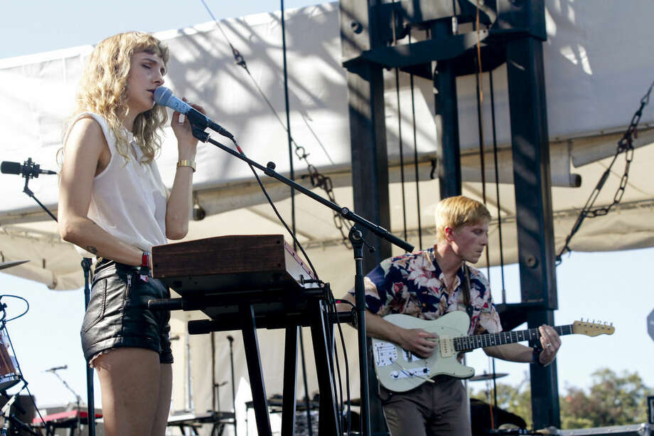 FILE - In this Oct. 14, 2012 file photo, Alaina Moore and Patrick Riley of Tennis perform at the Austin City Limits Music Festival in Austin, Texas. Riley, 28, had played in local bands and tried but failed to get work at record companies before taking a job at the Museum of Contemporary Art in Denver. Moore, 29, had studied music but was exploring law school. They married in 2009. (Photo by Jack Plunkett/Invision/AP, FIle)