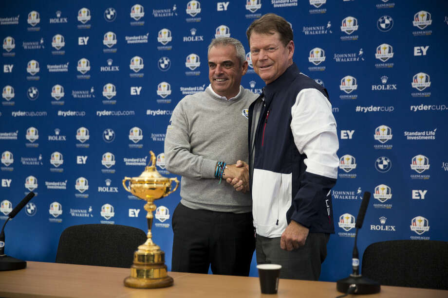 U.S. Ryder Cup team captain Tom Watson, right, and European Ryder Cup team captain Paul McGinley shake hands by the trophy at the end of a press conference for the golf tournament in Gleneagles, Scotland, Monday, Sept. 22, 2014. The U.S. team arrived for the Ryder Cup Monday, with the tournament starting on Friday. (AP Photo/Matt Dunham)