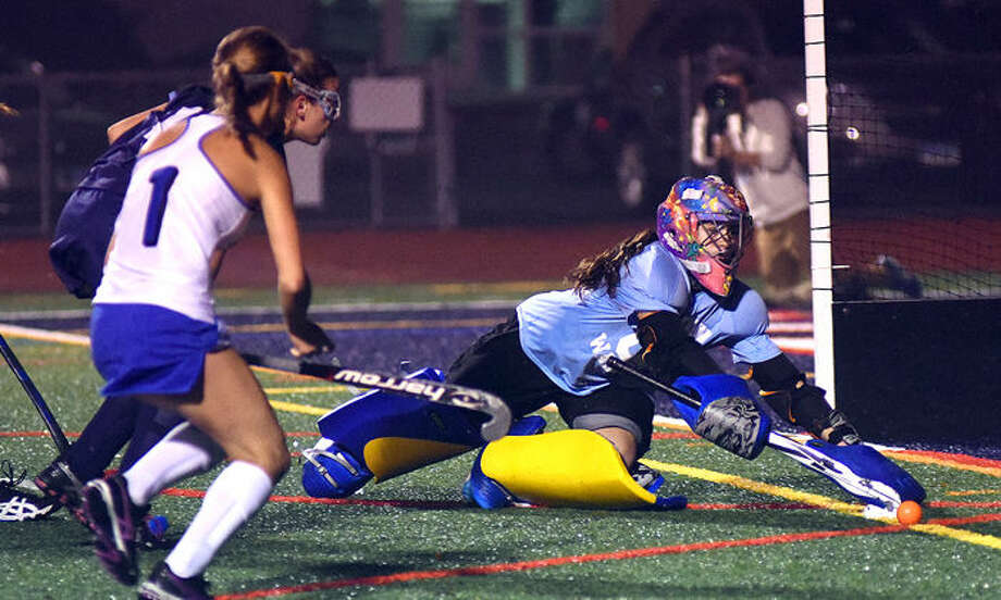 Hour photo/John Nash - Action from Thursday's FCIAC Field Hockey Championship game between Wilton and Darien at Casagrande Field. Darien won its 10th league title with a 1-0 win.
