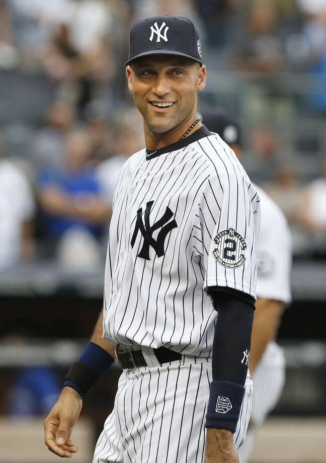 New York Yankees' Derek Jeter smiles after the baseball game against the Toronto Blue Jays at Yankee Stadium, Sunday, Sept. 21, 2014 in New York. The Yankees defeated the Blue Jays 5-2. (AP Photo/Seth Wenig)
