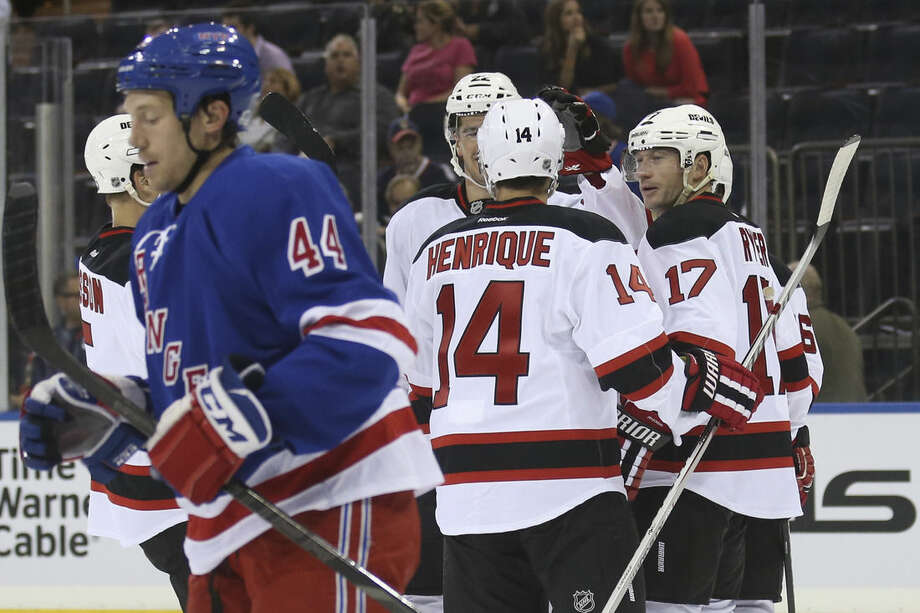 New Jersey Devils right wing Michael Ryder (17) celebrates with teammates after scoring during the first period of their preseason NHL hockey game against the New York Rangers, Monday, Sept. 22, 2014, in New York. (AP Photo/John Minchillo)