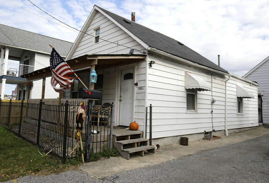 A Thursday, Nov. 5, 2015 photo shows the house where Julian Hernandez lived with his father, Bobby, in Cleveland. Thirteen years after Julian was allegedly snatched from his Alabama home at age 5 by his father, the young man has been found living under an assumed name with his dad in Ohio, in a case authorities say broke open when his Social Security number raised red flags during college applications. (AP Photo/Tony Dejak)
