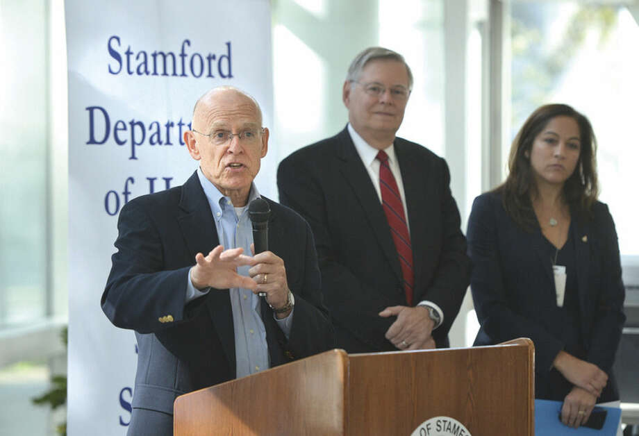 "Hour photo/Alex von KleydorffMichael Parry, MD, talks about ways to ""Fight The Flu"" during the campaign kickoff at the Government Center Tuesday. In middle, Thomas J Bradsell, chairman of Infectious Diseases at Stamford Hospital. Woman at right unidentified."