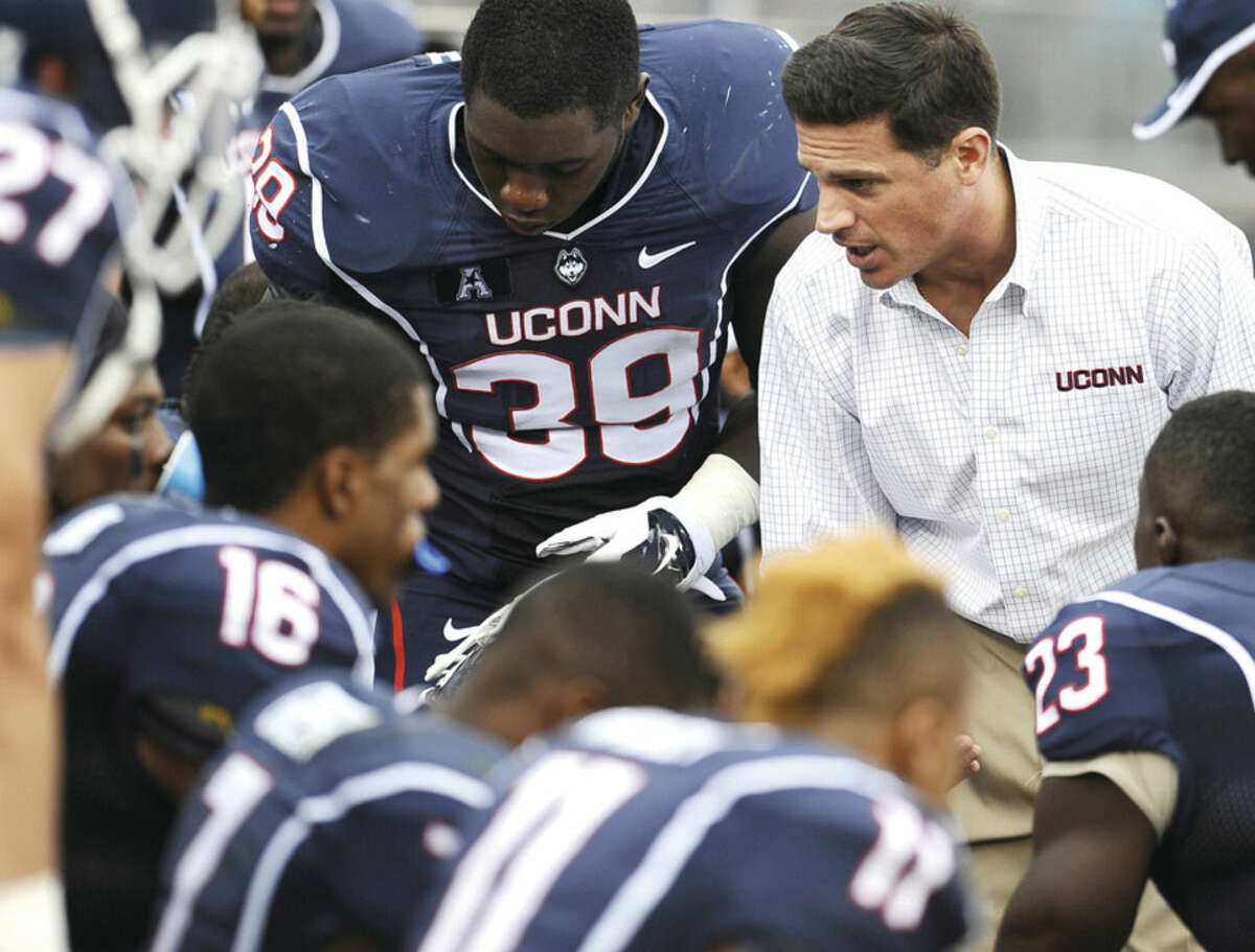 AP photo UConn head coach Bob Diaco, right, talks to his team during the second half of the Huskies' game against Boise State two weeks ago in East Hartford.