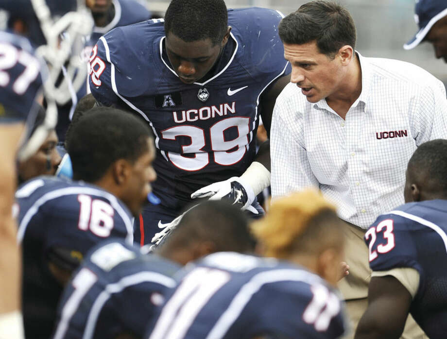 AP photoUConn head coach Bob Diaco, right, talks to his team during the second half of the Huskies' game against Boise State two weeks ago in East Hartford.