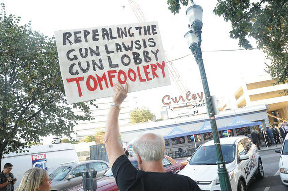 Gun safety protesters Tuesday outside of Curley's Diner in Stamford where New Jersey Governor Chris Christie attended a fundraiser for candidate Tom Foley. Hour photo/Matthew Vinci