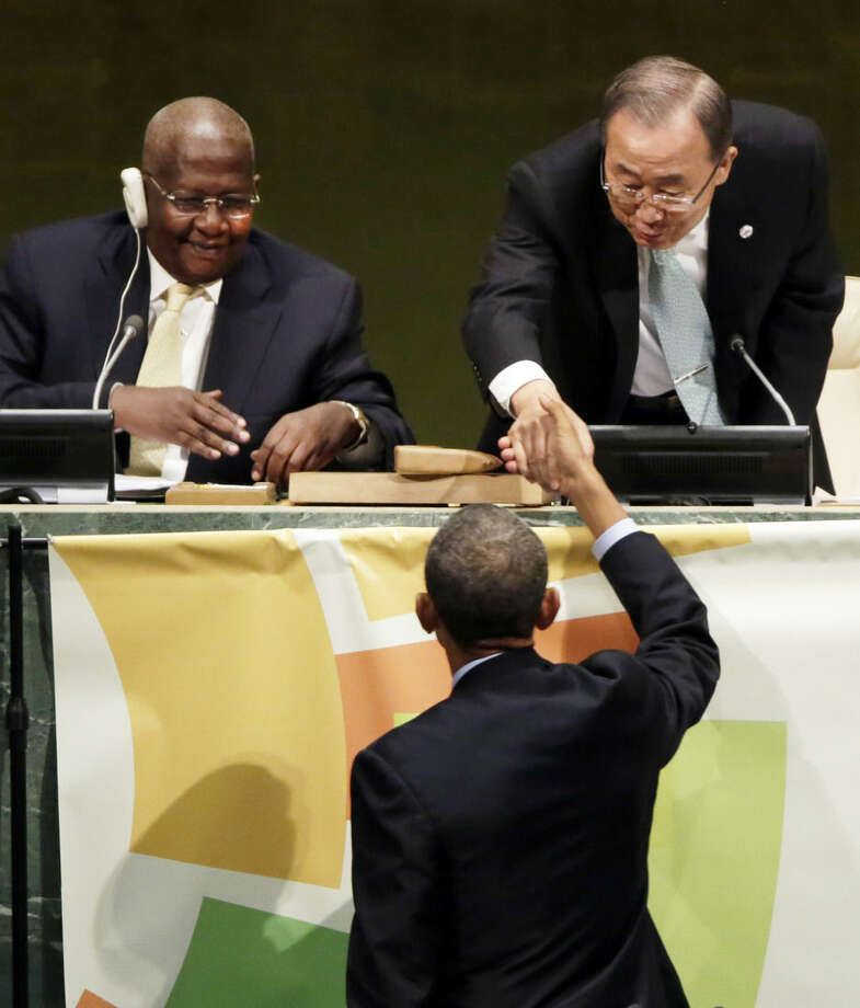 President Barack Obama, foreground, shakes hands with U.N. Secretary General Ban Ki-moon, upper right, and General Assembly President Sam Kutesa, of Uganda, after his address to the Climate Summit, at United Nations headquarters, Tuesday, Sept. 23, 2014. (AP Photo/Richard Drew)