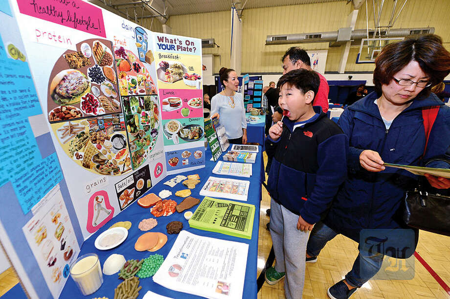Zachary Kim looks over healthy alternatives at The Hour Publishing Co. and Western Connecticut Health Network annual Health & Wellness Fair at Wilton Family Y Saturday.