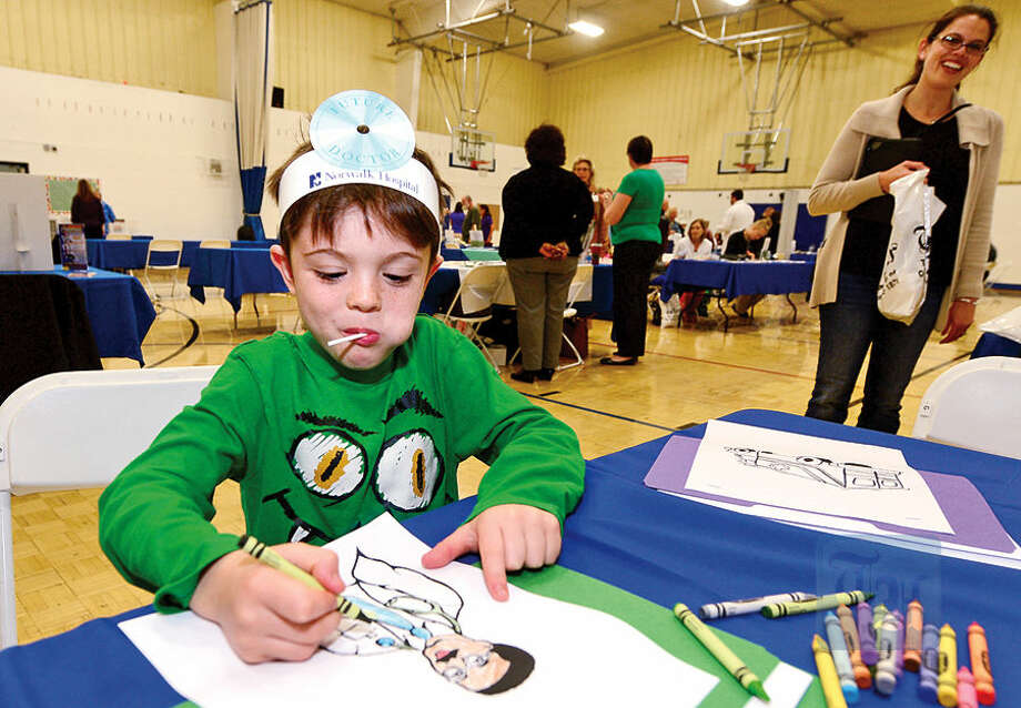 Six year old Jake Albanese colors at a table during The Hour Publishing Co. and Western Connecticut Health Network annual Health & Wellness Fair at Wilton Family Y Saturday.