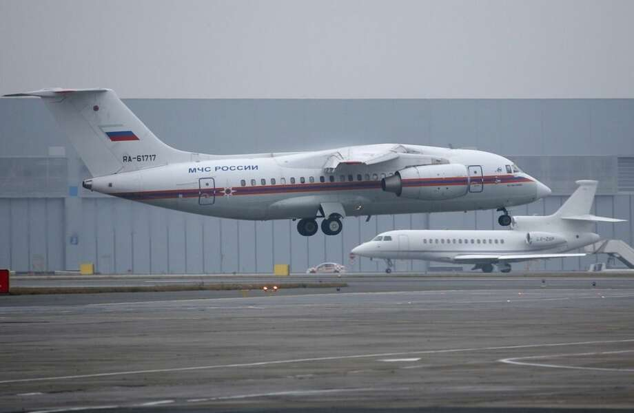 A Russian Ministry for Emergency Situations plane carrying the bodies of victims of a plane crash, lands at Pulkovo airport outside St. Petersburg, Russia, Friday, Nov. 6, 2015. All 224 people onboard a Russian jet en route from the Red Sea resort of Sharm el-Sheikh to Russia's St. Petersburg were killed in Saturday's plane crash. (AP Photo/Dmitry Lovetsky, Pool)