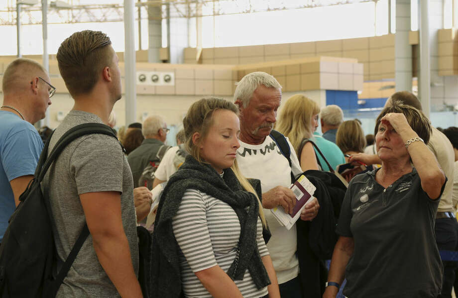 Tourists wait in the departure hall to be evacuated from Sharm el-Sheikh airport, south Sinai, Egypt, Friday, Nov. 6, 2015. Egyptian police carried out detailed security checks on Friday at the airport in Sharm el-Sheikh, the resort from where the doomed Russian plane took off last weekend, after U.K. officials confirmed that flights will start bringing stranded British tourists home from the Sinai Peninsula. (AP Photo/ Vinciane Jacquet)
