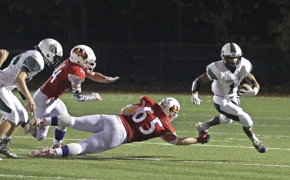 Hour photo/Danielle Calloway Norwalk's Dakari Eason, right, breaks free during a game against Greenwich at the Cardinals Stadium on Friday night.