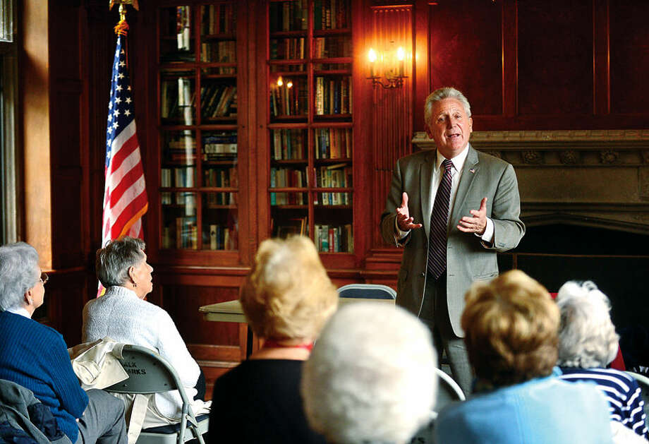 Hour photo / Erik Trautmann Norwalk Mayor Harry Rilling is the guest speaker at the Norwalk-Wilton AARP meeting at Gallaher Mansion at Cranbury Park Thursday. The mayor discussed major developments happening around the city and focused on beneficial changes that would affect seniors.