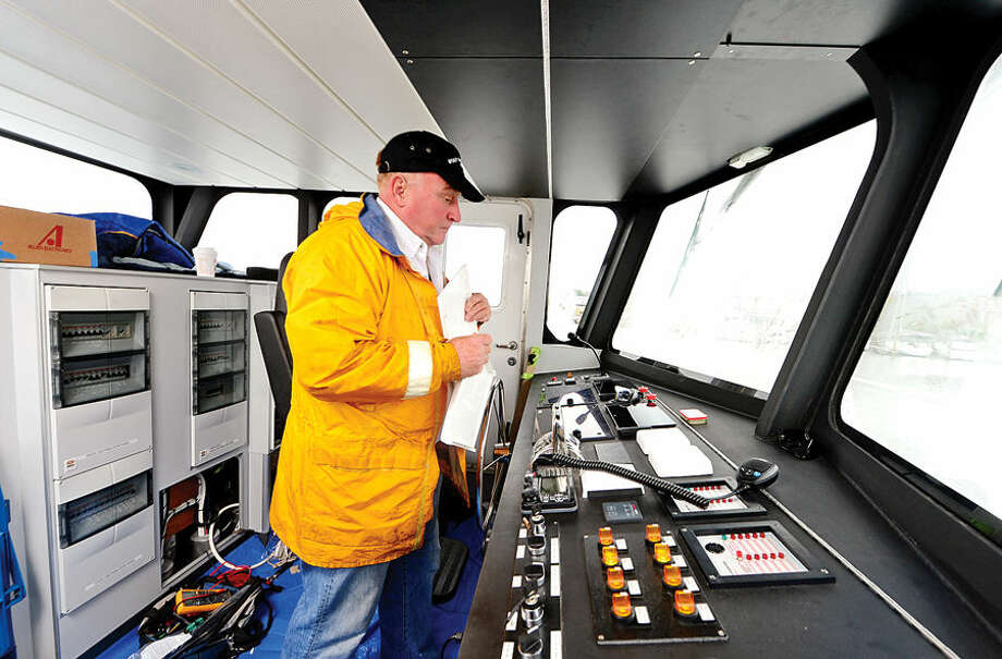 """Hour photo / Erik Trautmann Construction supervisor Bob Kunkel looks over the controls of the Martime Aquarium's new research vessel, R/V Spirit of the Sound. The 65-foot catamaran is bigger, quieter and """"greener"""" than the current research vessel. She will be the only research vessel in the country with a hybrid-electric propulsion system, so the vessel runs silently and significantly reduce fuel costs. The R/V Spirit of the Sound will double capacity for programming on the water from 29 to 60 participants per cruise."""