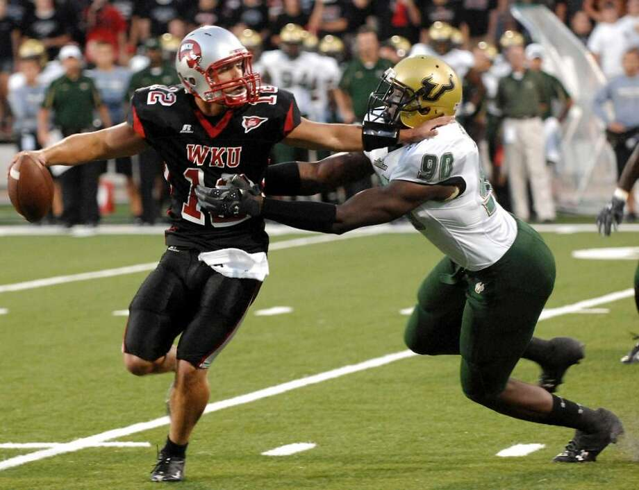 FILE - In this Sept. 12, 2009, file photo, South Florida's Jason Pierre-Paul (90) sacks Western Kentucky quarterback Brandon Smith during the first half of an NCAA college football game at Houchens-Smith Stadium in Bowling Green, Ky. Pierre-Paul is a top prospect in the NFL draft.  (AP Photo/Daily News, Joe Imel, File) Photo: Joe Imel, AP / AP2009