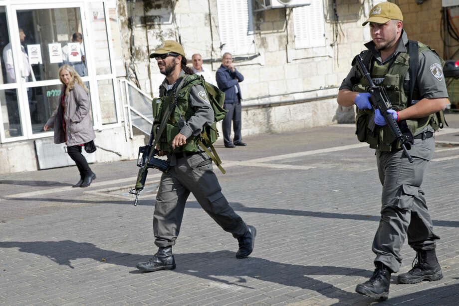 Israeli border police officers secure the site of an attempted stabbing attack outside Damascus Gate in Jerusalem's Old City, Tuesday, Nov. 10, 2015. Israeli police say Palestinian assailants have attempted to carry out a pair of stabbing attacks on Israelis in Jerusalem on Tuesday. (AP Photo/Ariel Schalit)