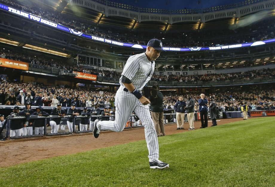 New York Yankees shortstop Derek Jeter takes the field for the Yankees' baseball game against the Baltimore Orioles, Thursday, Sept. 25, 2014, in New York. (AP Photo/Kathy Willens)
