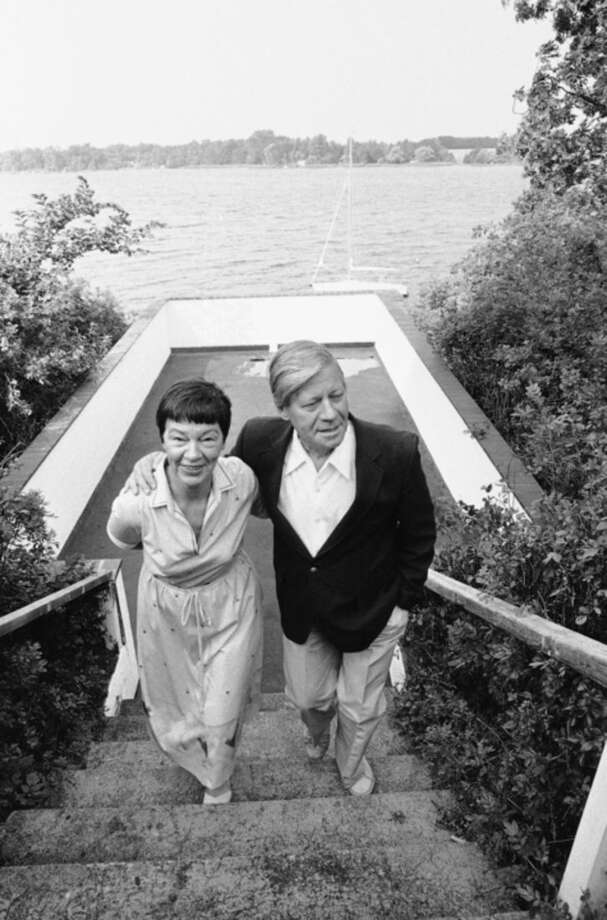 FILE - In this Aug. 13, 1982 file photo then West German Chancellor Helmut Schmidt and his wife Hannelore walk upstairs near the Brahmsee, a little lake in Northern Germany where the couple spent their summer holidays. Helmut Schmidt died Nov. 10, 2015. He was 96. (AP Photo/Fritz Reiss, file)