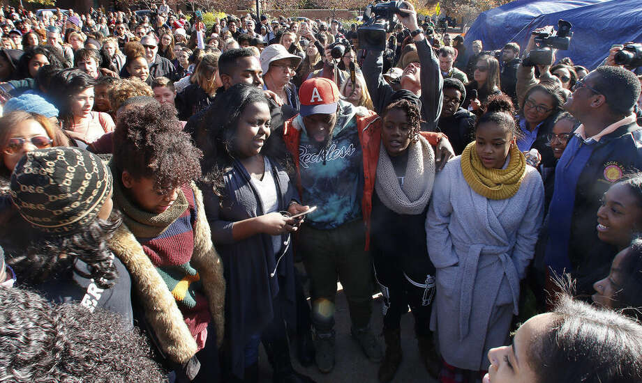 Supporters gather after the announcement that University of Missouri System President Tim Wolfe would resign Monday, Nov. 9, 2015, in Columbia, Mo. Wolfe resigned Monday with the football team and others on campus in open revolt over his handling of racial tensions at the school. (Matt Hellman/Missourian via AP) MANDATORY CREDIT
