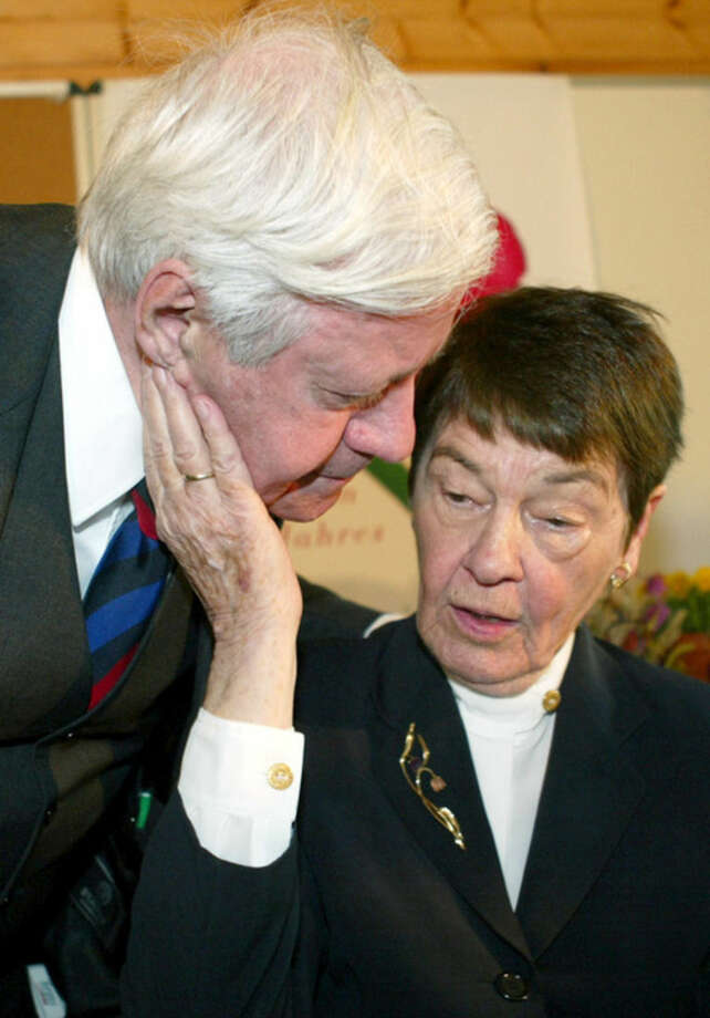 FILE - In this April 1, 2003 file photo former German Chancellor Helmut Schmidt, left, says goodbye to his wife Hannelore 'Loki' after a book presentation in Hamburg, northern Germany. Helmut Schmidt died Nov. 10, 2015. He was 96. (AP Photo/Fabian Bimmer, file)