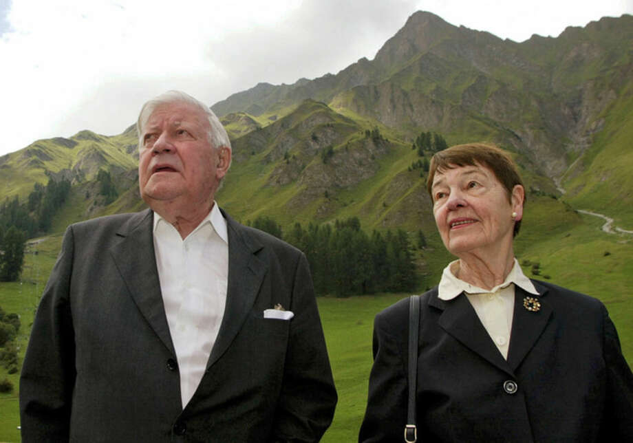 FILE - The Aug. 1, 2003 file picture shows former West German chancellor Helmut Schmidt, left, and his wife Loki during their holiday in Samnaun, Switzerland. Helmut Schmidt died Nov. 10, 2015. He was 96. (Arno Balzarini/Keystone, file via AP)