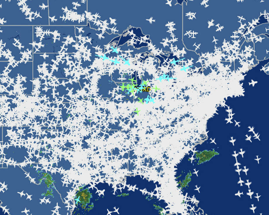 This screen shot provided by FlightAware shows airline traffic at 10:20 a.m. EDT over the United States Friday, Sept. 26, 2014, after hundreds of flights were canceled at Chicago airports, at center, following a fire at a suburban Chicago air traffic control facility. The ground stop threatened to send delays and cancellations rippling throughout the nation's air travel network, as more than 500 flights had already been canceled in Chicago and more were expected. (AP Photo/Courtesy FlightAware)