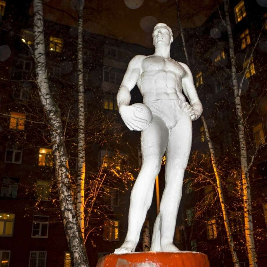 A Soviet style statue of a water polo player is seen at a yard between buildings in Moscow, Russia, Tuesday, Nov. 10, 2015. A report Monday by a commission of the World Anti-Doping Agency accused Russia of widespread, state-sponsored doping and cover-ups by sports officials and track and field athletes, including Olympic medalists. (AP Photo/Pavel Golovkin)