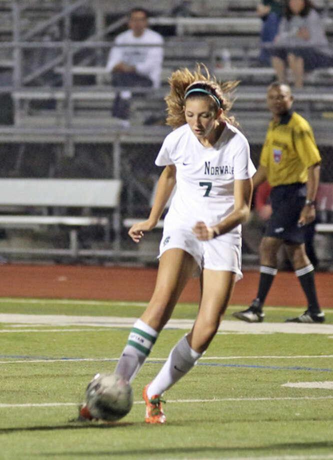 Hour Photo / Danielle CallowayNorwalk's Natalie LaBella, kicks the ball during Friday night's game against Trinity at Norwalk High School.