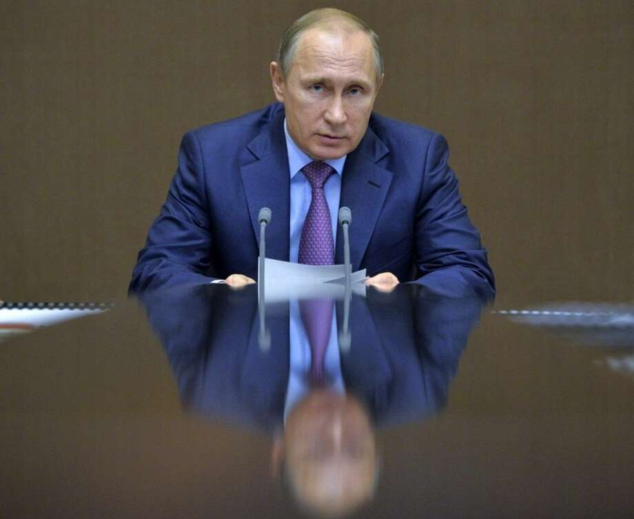 Russian President Vladimir Putin chairs a meeting with defense officials in the Bocharov Ruchei residence in the Black Sea resort of Sochi, Russia, Tuesday, Nov. 10, 2015. President Vladimir Putin said Tuesday that Russia will counter NATO's U.S.-led missile defense program by deploying new strike weapons capable of piercing the shield. (Alexei Druzhinin/RIA Novosti, Kremlin Pool Photo via AP)