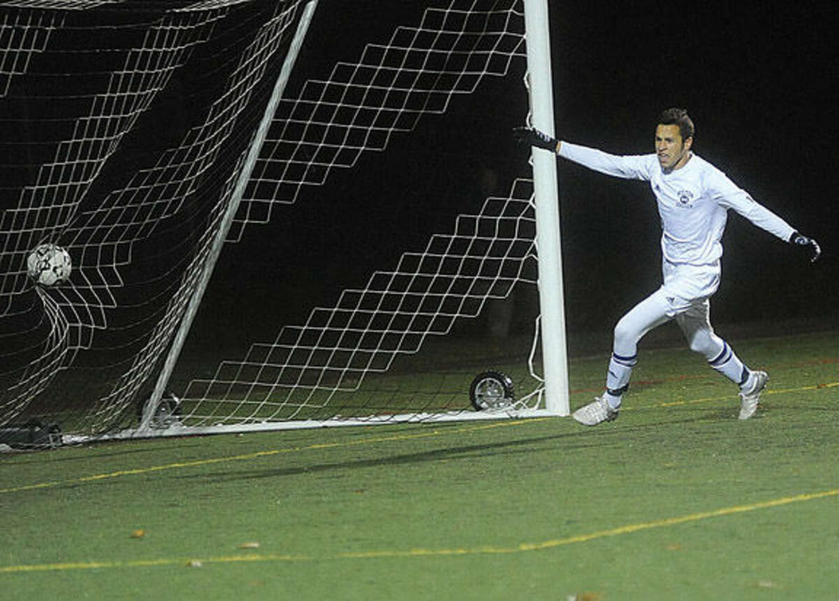 Wilton's Harry Allers scores the goal of the game. Hour photo/Matthew Vinci