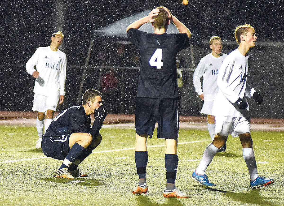Hour photo/John Nash - Staples' Joshua Berman, left, and Daniel Brill (4) react after missing a good scoring opportunity in the second half of Tuesday's CIAC Class LL boys soccer first round tournament game against Hall in West Hartford.