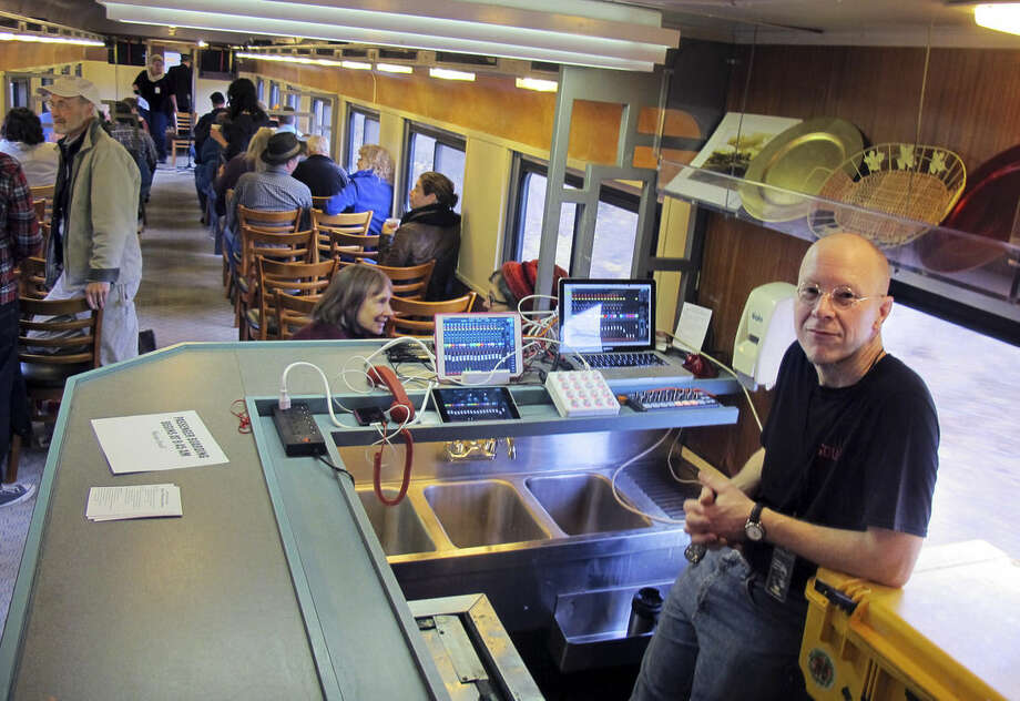 In this Saturday Nov. 7, 2015 photo, sound technician Dan Richardson rides aboard the Roots on the Rails music train during its first East Coast excursion between Bellows Falls and Rutland, Vt. About 50 passengers spent the day listening to music while riding in vintage rail cars of the Green Mountain Express rolling through the countryside. (AP Photo/Wilson Ring)
