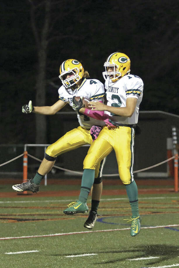 Photo by Danielle CallowayTrinity Catholic's Johnny Somers, left, is congratulated by quarterback Anthony Lombardi after scoring a touchdown during a game against Stamford High School at Boyle Stadium Friday evening.